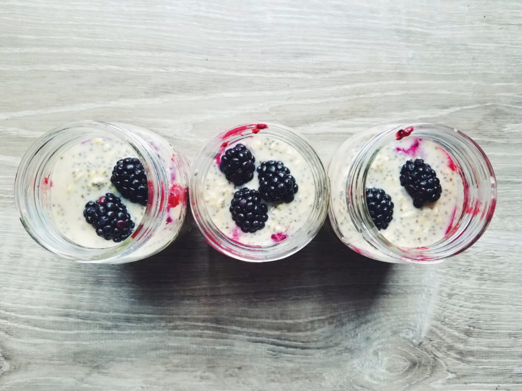blackberry high protein overnight oats in mason jars