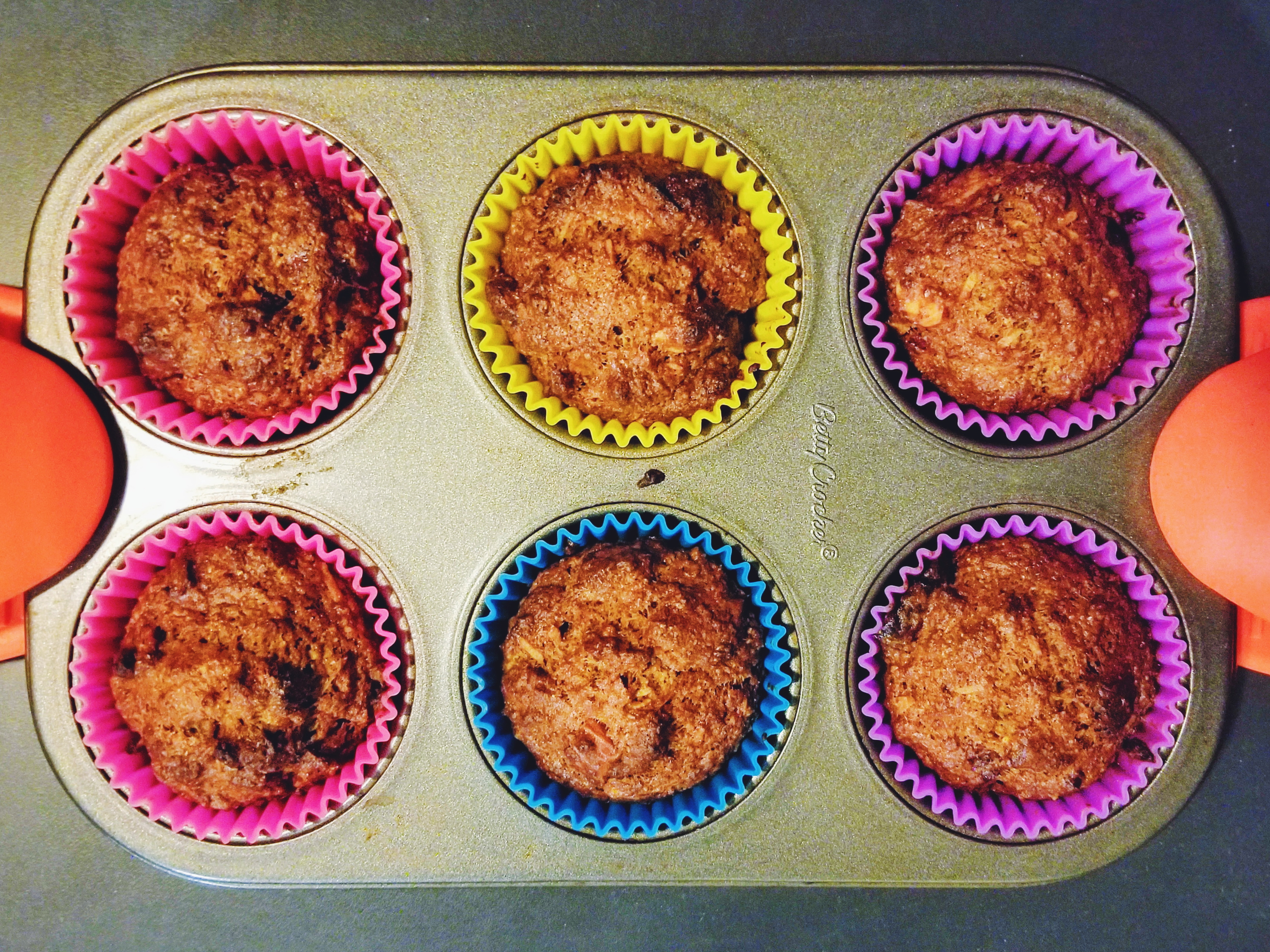 healthier morning glory muffins in muffin tin
