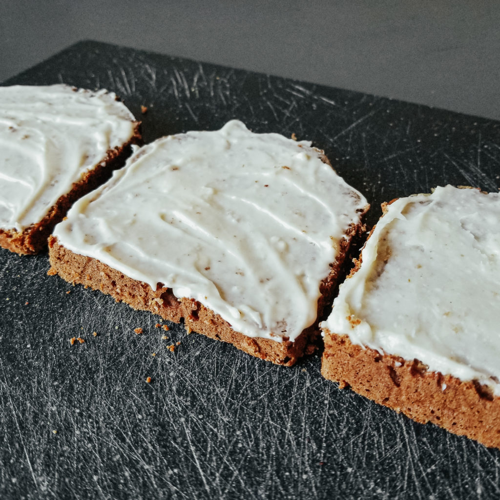 cream cheese frosting on rye banana bread slices