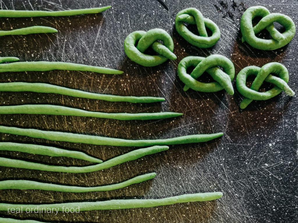 rolling homemade spinach pici pasta