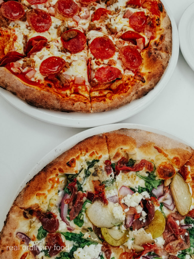 meat lover pizza and pear & goat cheese pizza from antica pizzeria & ristorante niagara falls