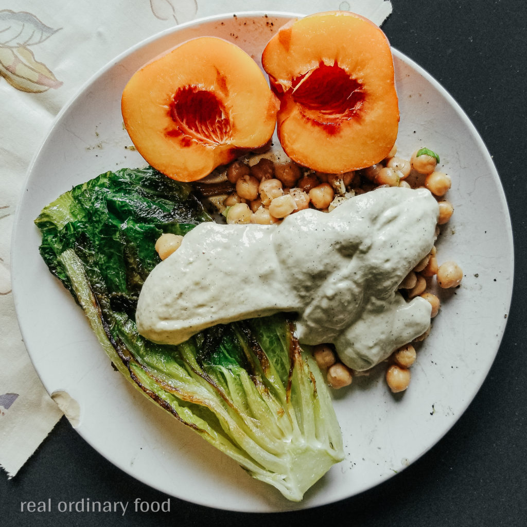 grilled romaine caesar salad with herby chickpeas and peach