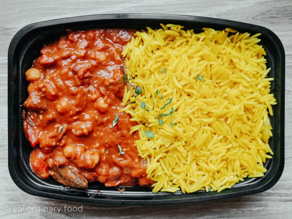 meal prepped vegan okra gumbo over yellow rice