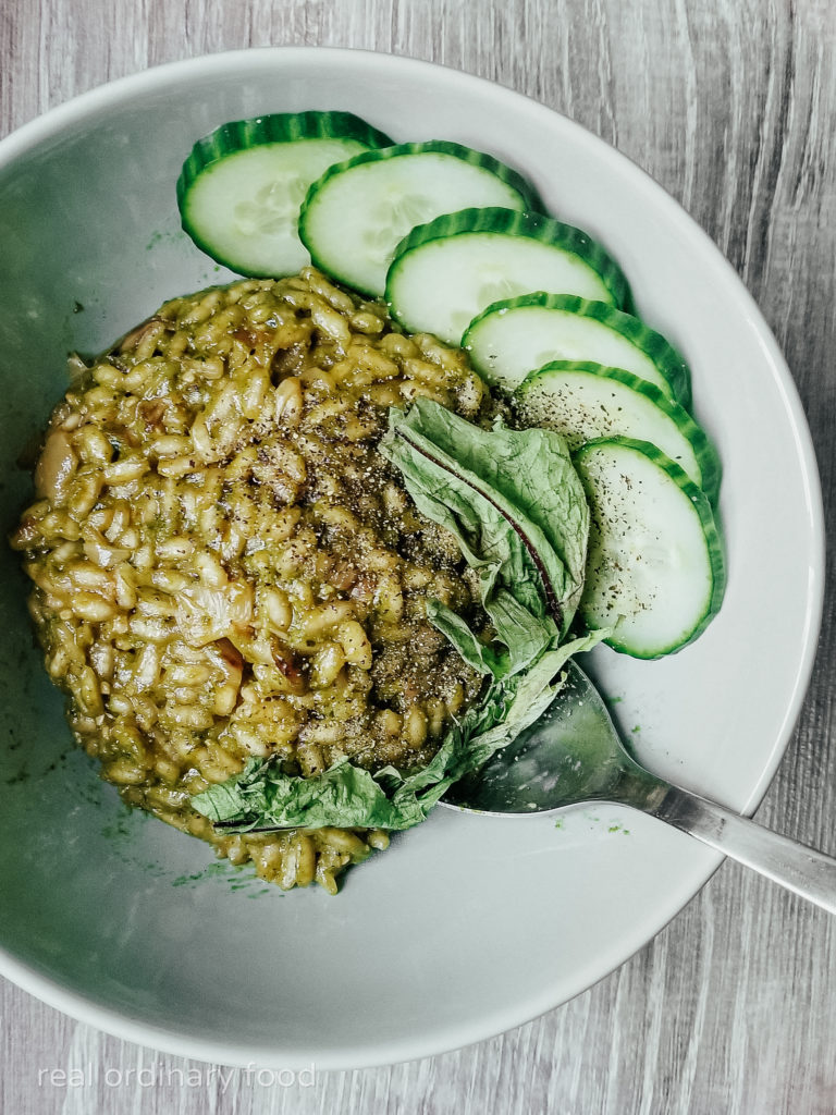green dandelion risotto with cucumber slices
