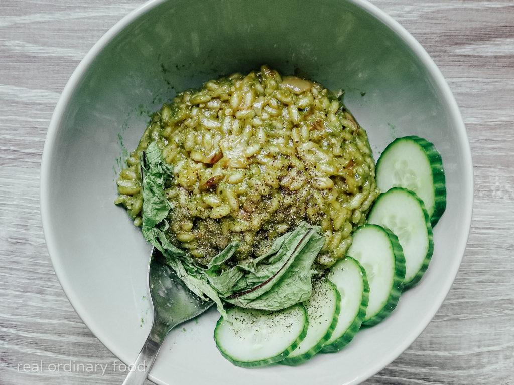 green dandelion pesto risotto with cucumber slices