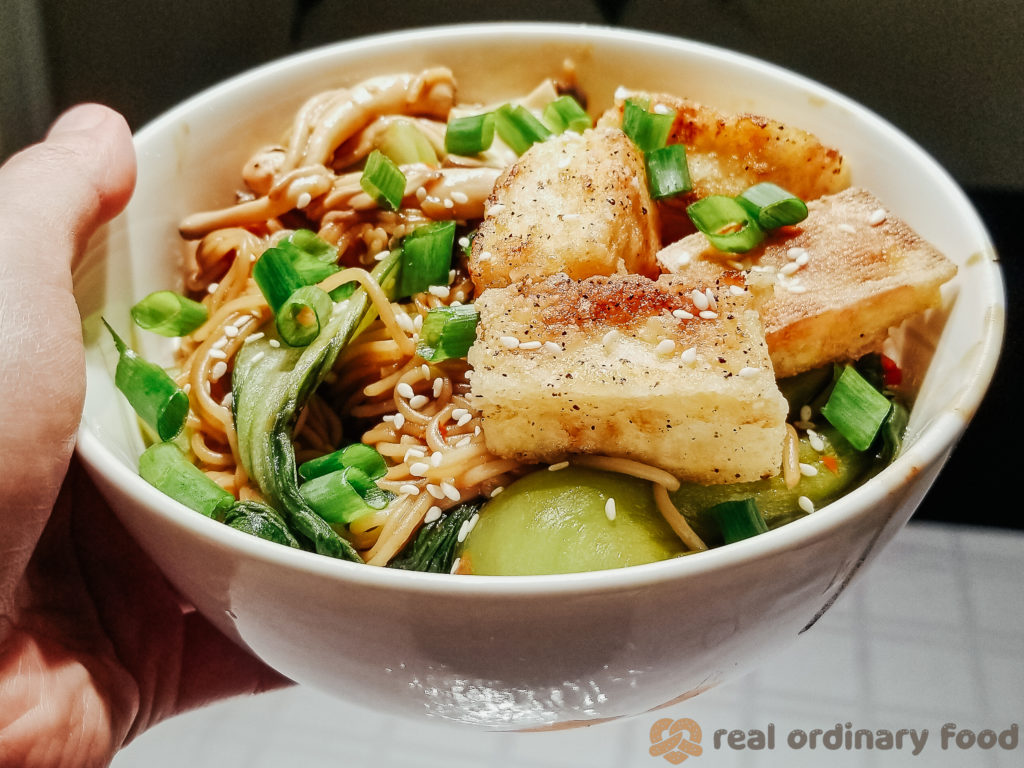 pan-fried soft tofu over brown rice noodles with bok choy and oyster mushrooms
