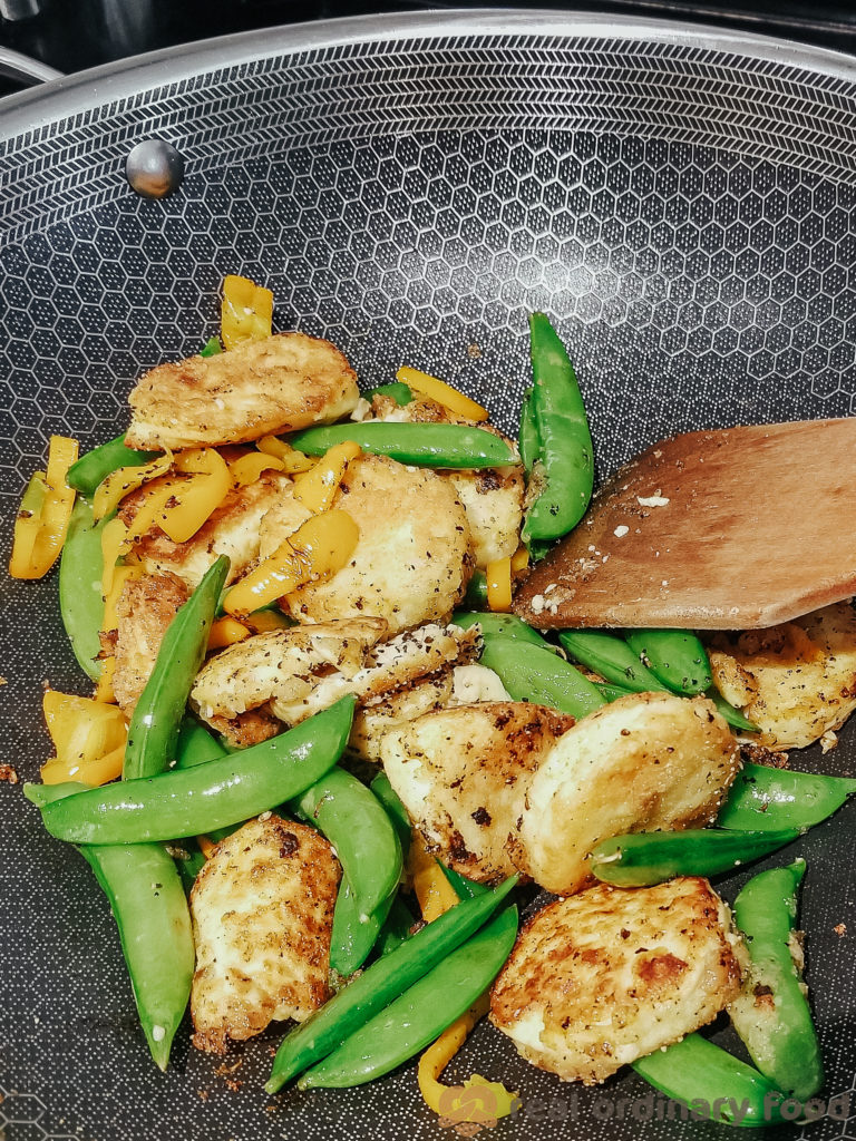 stir-frying soft tofu with snap peas and bell pepper