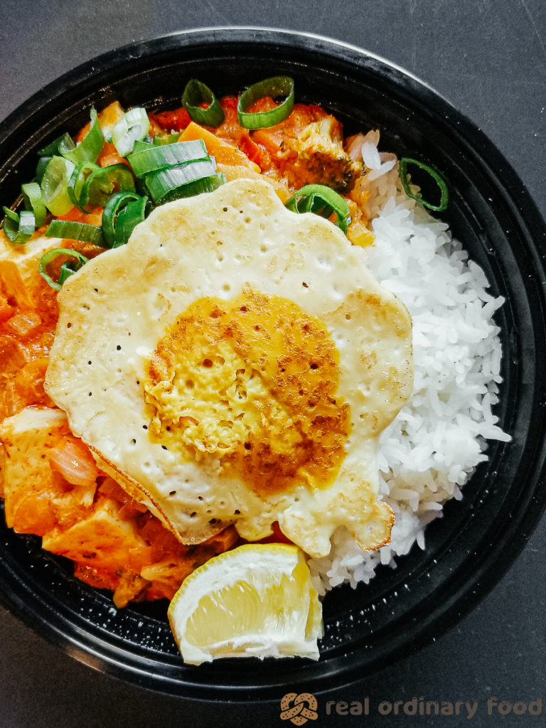 vegan fried egg over thai red curry