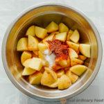 adding salt and shichimi togarashi to chopped potatoes