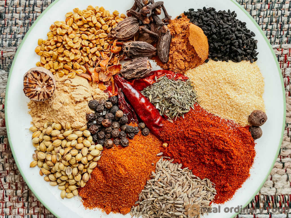 plateful of spices for berbere seasoning