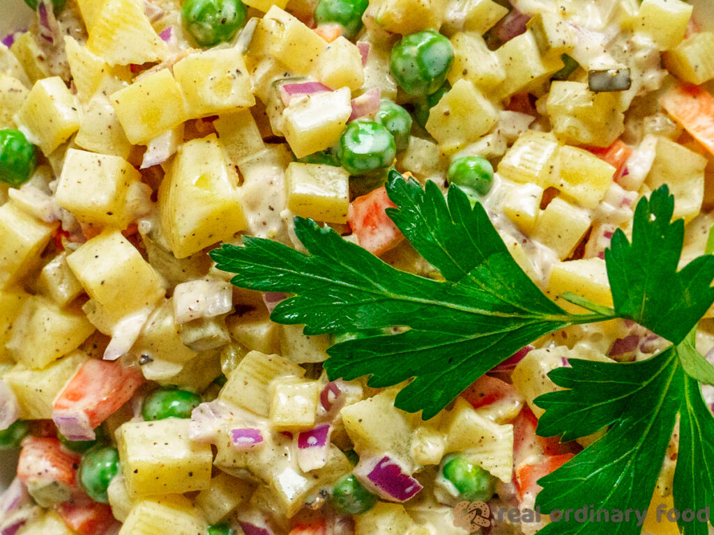 vegan olivier salad with parsley sprig