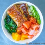 vegan sashimi poke bowl with spinach, cucumber, mango